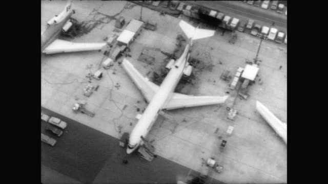 Aerial pan of planes parked on runway in Washington DC / aerial of Boeing's new plane 727200 / plane takes off on maiden flight / plane in sky