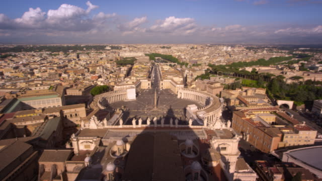 aerial pan of st. peter's plaza and the rooftops of rome - state of the vatican city stock videos & royalty-free footage