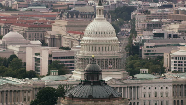 aerial pan on united states capitol building, washington d.c. - united states congress stock-videos und b-roll-filmmaterial