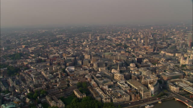 Aerial pan over London cityscape and Thames