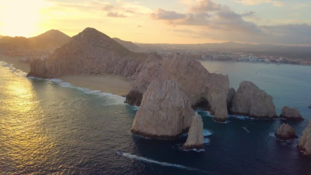 aerial pan right to left: beautiful beach in mexico - cabo san lucas stock videos & royalty-free footage