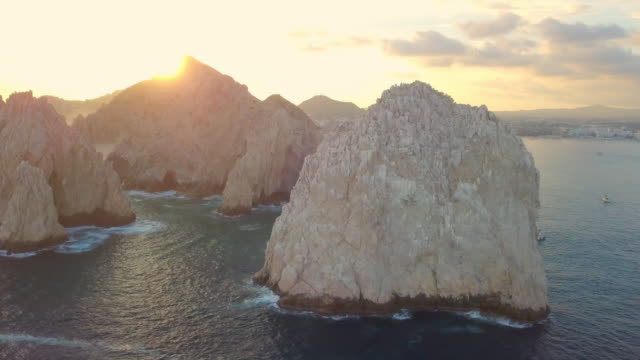 aerial pan right to left: beautiful mexico rock cliffs - arch stock videos & royalty-free footage