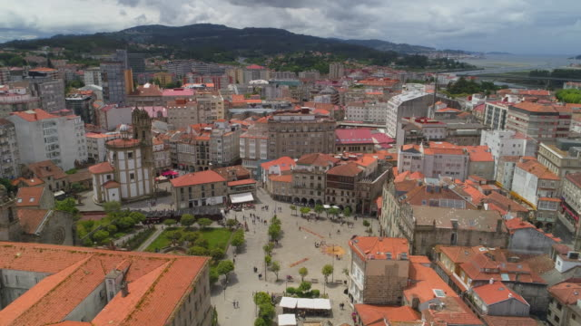 aerial pan right to left: bright hot sunny day in the small town - pontevedra, spain - galicia stock videos & royalty-free footage