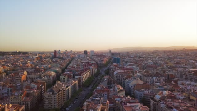 vídeos de stock, filmes e b-roll de aerial pan right to left: saturated city of spain - panning