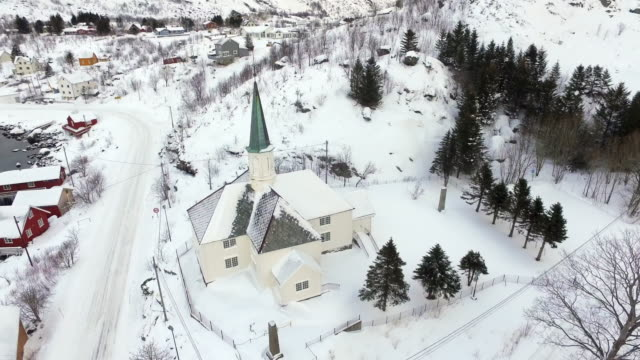 aerial pan right to left: small snow covered church in lofoten norway - lofoten, norway - church stock videos & royalty-free footage