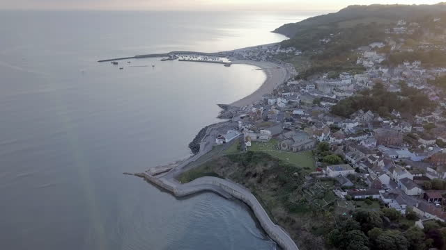 aerial pan right to left: small town by the sea with view - dorset, england - town stock videos & royalty-free footage