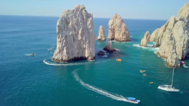 aerial pan right to left: tourist boats in mexico - cabo san lucas stock videos & royalty-free footage