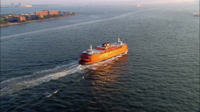 aerial pan staten island ferry in new york harbour/ new york, new york - staten island stock videos and b-roll footage