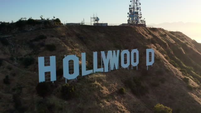 aerial pan: the hollywood sign on a sunny day - hollywood, california - hollywood sign stock videos & royalty-free footage