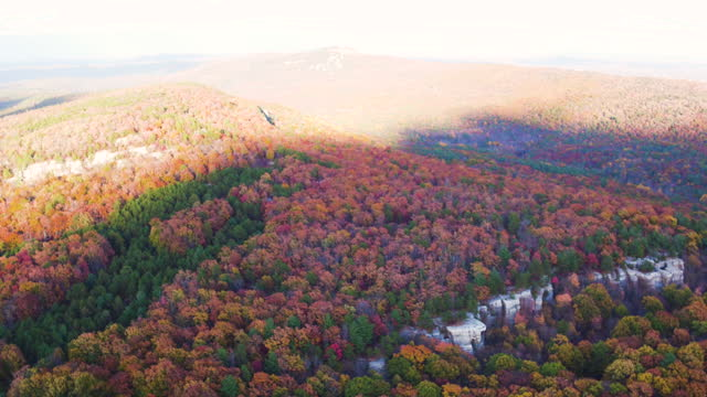 aerial pan up from mountains with beautiful leaf colors on trees - ulster county stock videos & royalty-free footage