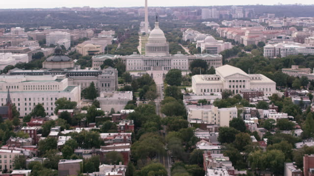 aerial pan up to united states capitol building, washington d.c., daytime - capitol building washington dc stock videos & royalty-free footage
