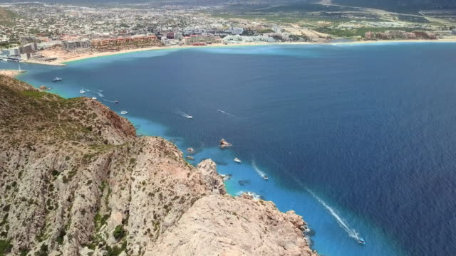 aerial pan upward: exciting bay of cabo san lucas - cabo san lucas stock videos and b-roll footage