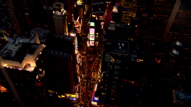 Aerial pan zoom in Times Square at night/ New York City