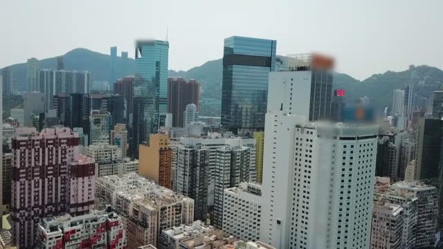 aerial: panning almost 360 degrees around hong kong city and harbor - セントラルプラザ点の映像素材/bロール