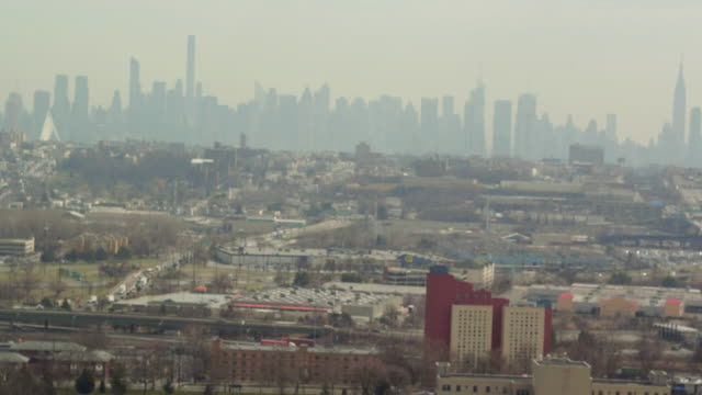 Aerial panning along the NYC skyline from an industrial area in new Jersey