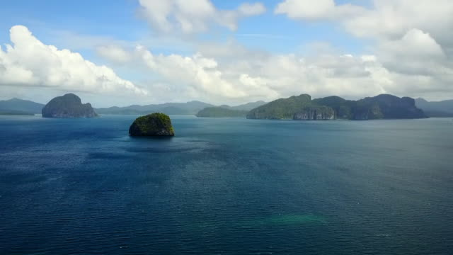 aerial: panning around ocean landscape with many islands in palawan, philippines - anchored stock videos & royalty-free footage
