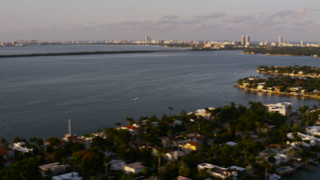 stockvideo's en b-roll-footage met aerial panning left across from south beach to downtown miami, fl - macarthur causeway bridge