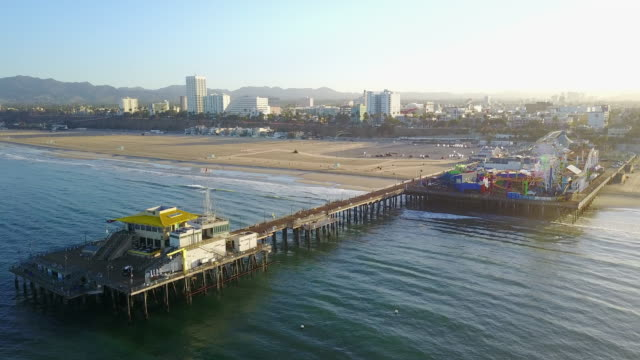 aerial panning of santa monica pier - santa monica pier stock videos & royalty-free footage