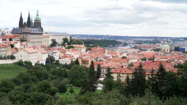 aerial panning: old prague city is in front of forest mountain - traditionally czech stock videos & royalty-free footage