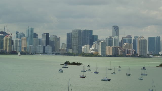 aerial panning over the ocean in front of the miami skyline - anchored stock videos & royalty-free footage