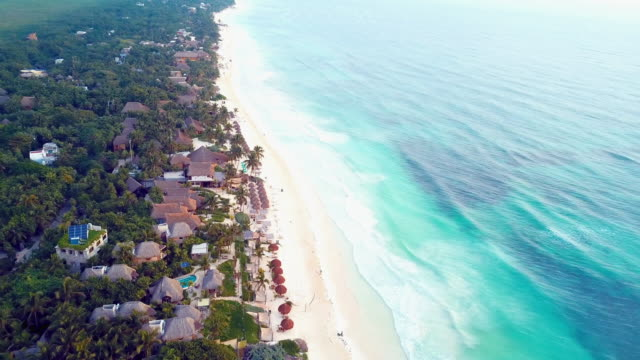 aerial: panning right to left: sea and beach front - tulum mexico stock videos & royalty-free footage