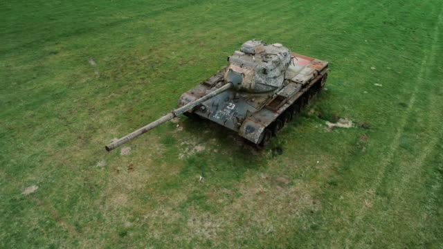 aerial panning shot of an abandoned tank, germany - 戦車点の映像素材/bロール