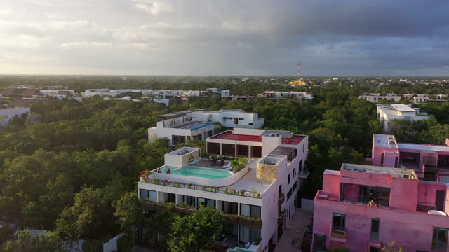 aerial panning shot of tourists enjoying vacation on hotel rooftop - tulum, mexico - hotel stock videos & royalty-free footage