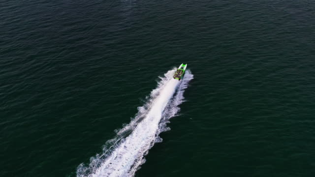 aerial panning shot showing a powerboat at sea, miami, florida, united states of america - miami dade county stock videos & royalty-free footage