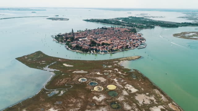 aerial panning shot showing the island of burano, venetian lagoon, italy - tide stock videos & royalty-free footage