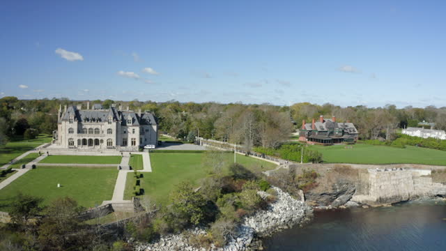 aerial panning the historic and stately mansions of salve regina university along the famous newport cliff walk - cultures stock videos & royalty-free footage