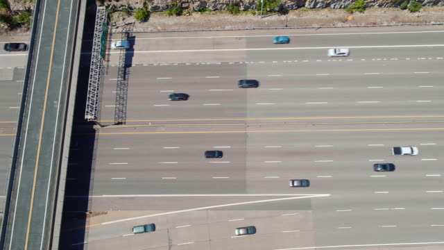 Aerial panning view of traffic on major highway
