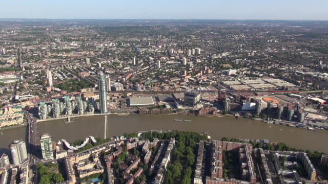 Aerial panorama along the River Thames looking south, from New Covent Garden to Vauxhall Bridge including the Secret Intelligence Building (MI6), St George Wharf Tower and views over south London