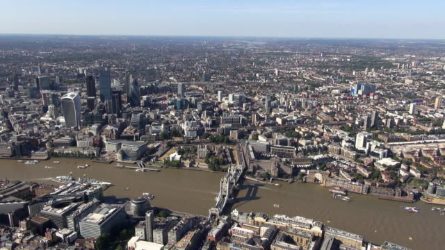 aerial panorama of city of london with iconic buildings, river thames, tower bridge and south bank including hms belfast, city hall and tower of london, with views over north london - tower of london stock videos and b-roll footage