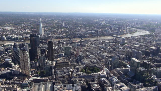 aerial panorama of city of london with iconic skyscrapers including the gherkin, heron tower, tower 42, finsbury circus and bank, with a backdrop of  the river thames winding through west london - filming stock videos and b-roll footage