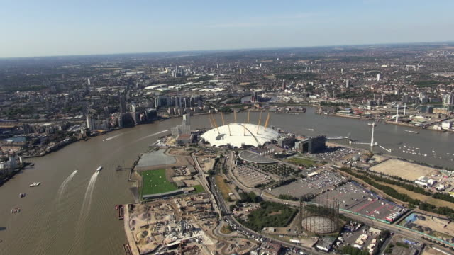 aerial panorama of east london from london city airport and silvertown over the o2 arena to canary wharf, isle of dogs and the river thames towards central london - the o2 england stock videos & royalty-free footage