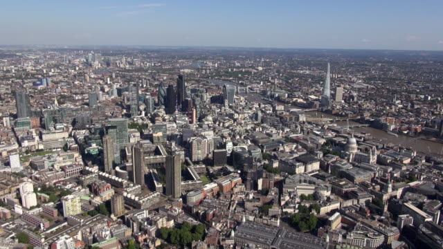 Aerial panorama of The Barbican Centre and City of London with views over River Thames, south bank and The Shard, east and south east London