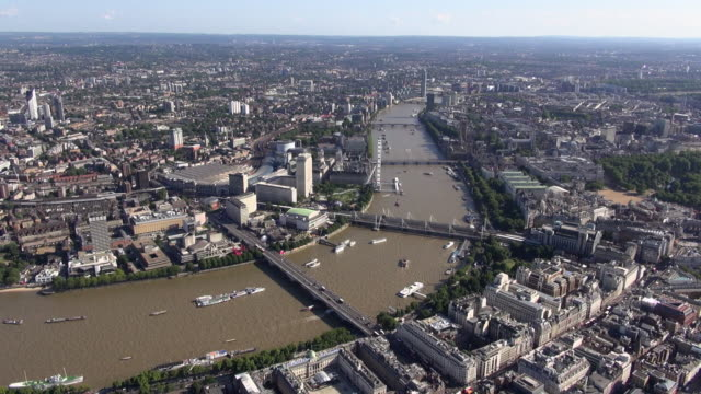 aerial panoramic video looking over the thames south bank, and westwards along the thames from waterloo bridge, with hungerford bridge, london eye and waterloo station - hungerford bridge stock videos & royalty-free footage