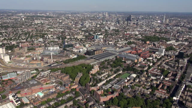 aerial panoramic video of st pancras international station and kings cross central building development site, st pancras hospital and surrounding areas, with distant views south eastwards over the city of london and beyond - surrounding stock videos and b-roll footage