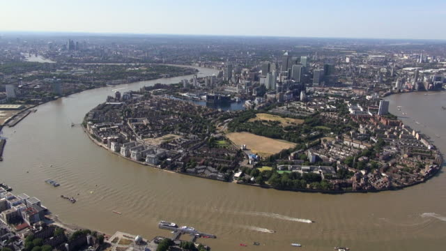 aerial panoramic video, panning along the river thames from city of london, past canary wharf and millwall park, isle of dogs with greenwich in foreground, ending at o2 arena - the o2 england stock videos & royalty-free footage