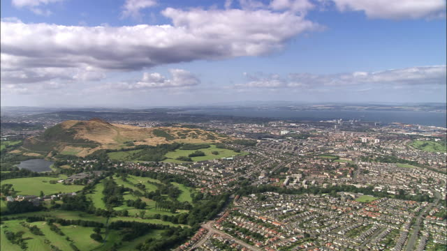 Aerial panoramic view of Arthur's Seat in Holyrood Park and of central Edinburgh / Scotland