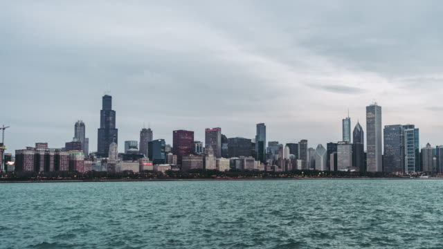 t/l ws pan aerial panoramic view of chicago at dawn, night to day transition - chicago loop stock videos and b-roll footage