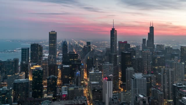 t/l ha tu aerial panoramic view of chicago, sunset to night transition - chicago loop stock videos and b-roll footage