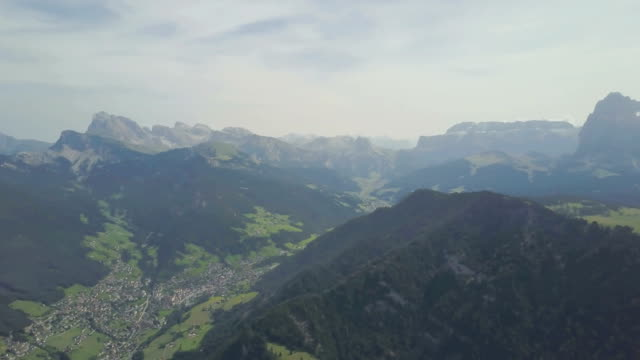 aerial panoramic view of dolomites - val gardena and seiser alm - dolomites - scilia stock videos & royalty-free footage