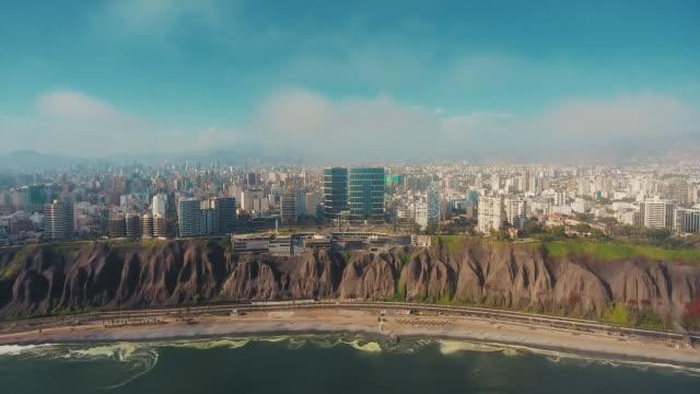 aerial panoramic view of miraflores district coastline in lima, peru. - peru stock videos & royalty-free footage