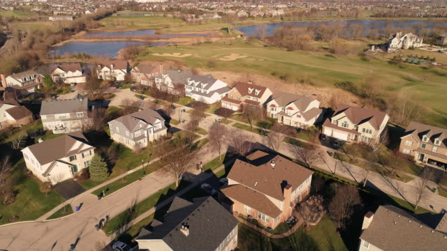 aerial panoramic view of the residential neighborhood libertyville, vernon hills, chicago suburban area, illinois. cinematic aerial drone video with the ascending camera motion. - chicago illinois stock videos & royalty-free footage