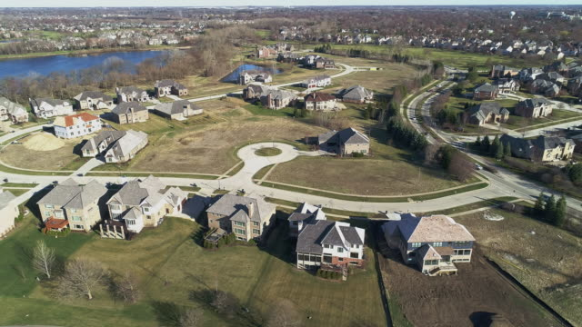aerial panoramic view of the residential neighborhood libertyville, vernon hills, chicago suburban area, illinois. cinematic aerial drone video with the panoramic camera motion. - village stock videos & royalty-free footage