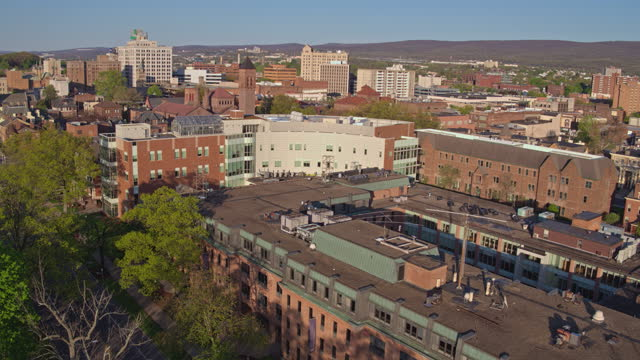 aerial panoramic view of wilkes-barre cityscape, pennsylvania, in springtime. drone-made footage with the forwarding-panning complex camera motion. - wilkes barre stock videos & royalty-free footage