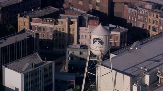 aerial ms ts paramount water tower and backlot at paramount pictures / hollywood, california, united states. - atelier stock-videos und b-roll-filmmaterial