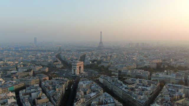 aerial: paris city away from arc de triomphe and traffic circle, france - triumphbogen paris stock-videos und b-roll-filmmaterial