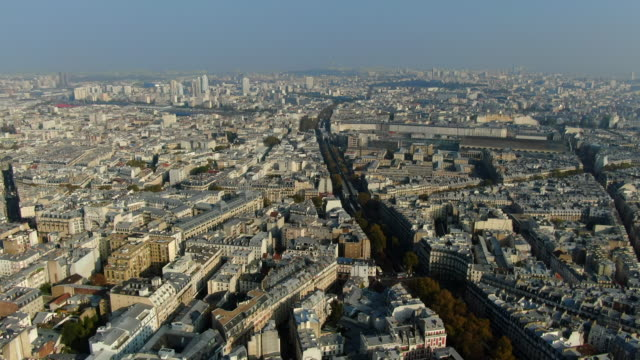 aerial: paris cityscape with a multitude of buildings and rooftops, france - île de france stock-videos und b-roll-filmmaterial